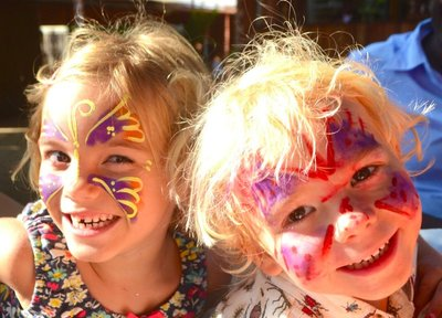 Kids got their faces painted at the Arua Christmas trade fair