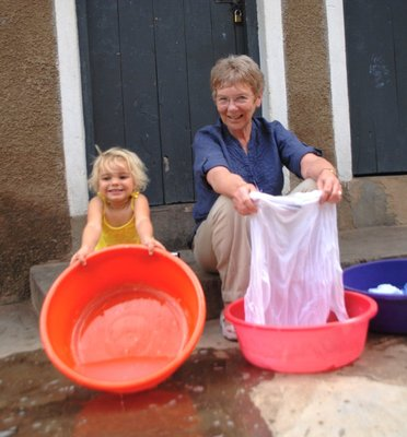 Aunt Barbara and Amelie washing by hand