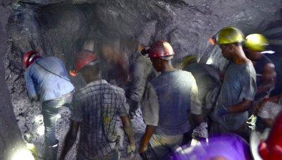 Miners look on