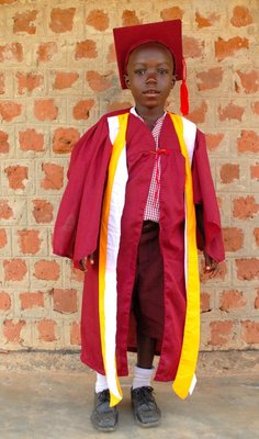 Children graduate in full regalia from nursery school