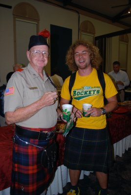 Kilted Piper and Me eating cookies together. He had never been outside the USA