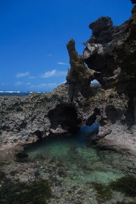 Rock pool among the jagged coral
