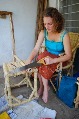 Emma (trying) to make a bamboo xylophone