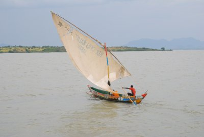 A Dhow plys its trade in the evening light on Lake Victoria