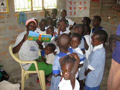 Children at Orongo enjoying a new book