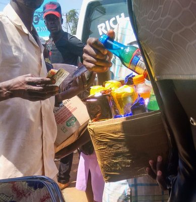 Selling juice to matatu passengers