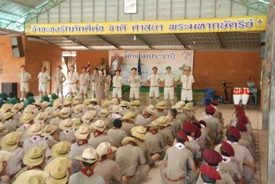The scout leaders (aka teachers) line up in front of the assembled scouts from three different schools