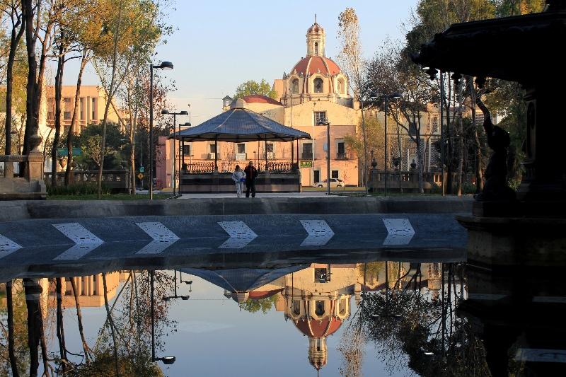 Church reflected in a fountain