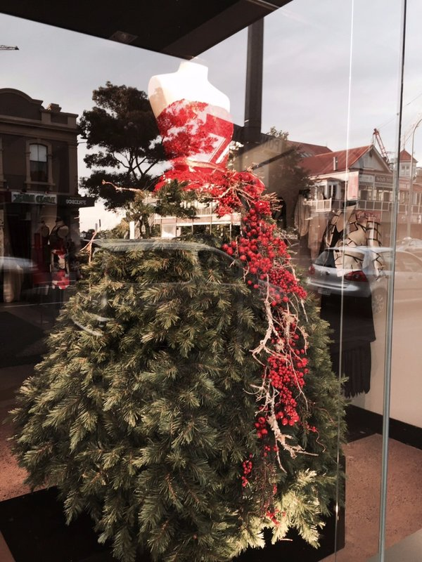Interesting window display - a gown as a Xmas tree