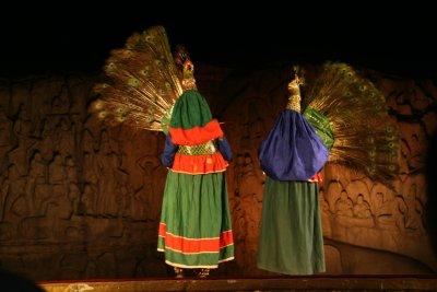 Men dancing in Peacock oufits