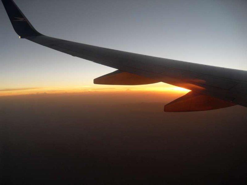 Sunset wing plane photo