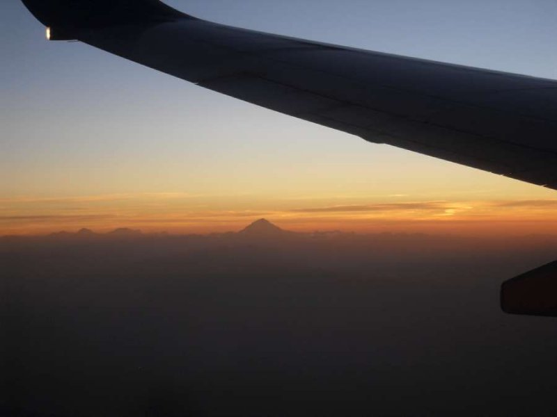 Wing and sunset and mountain