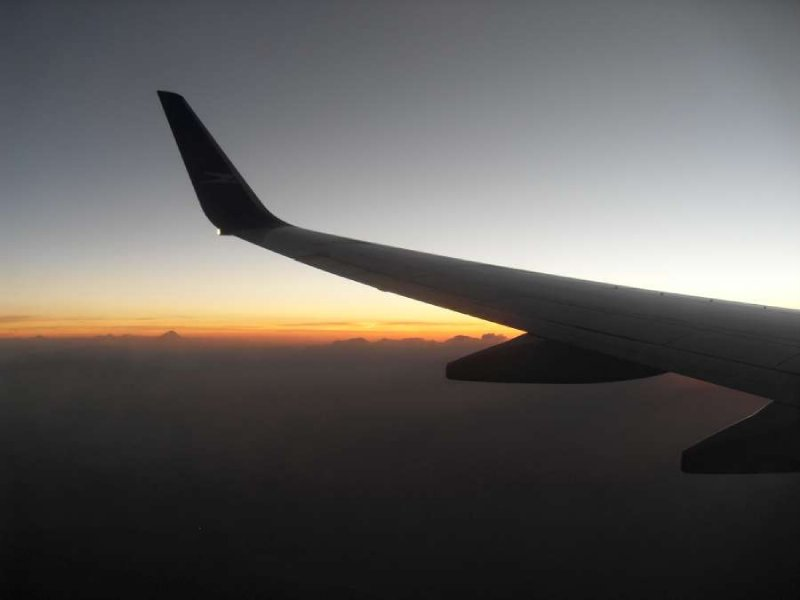 Another plane wing and sunset