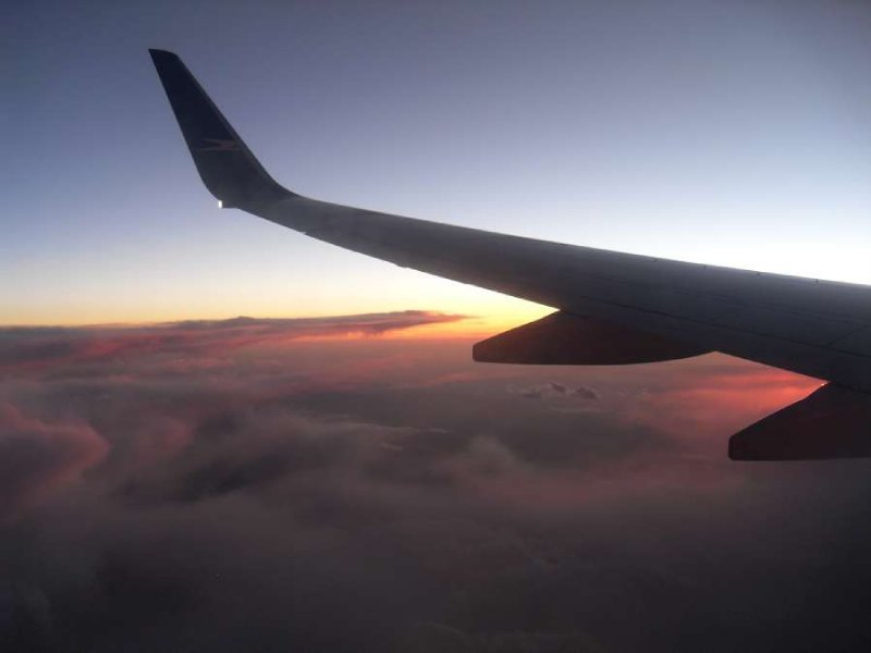 Pacific sunset plane wing