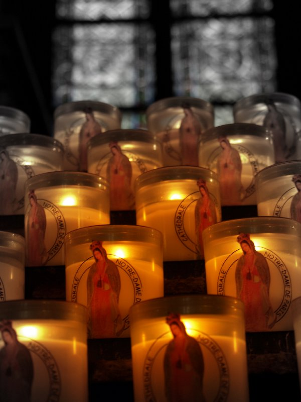 Candles inside of Notre Dame
