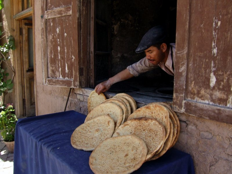 Fresh Bread for Sale out of His Back Window