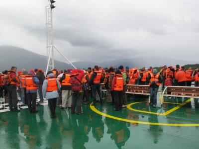 Waiting on deck to board into the little life boats for Puerto Eden