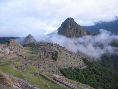 Early morning mist and our first glimpse of Machu Picchu