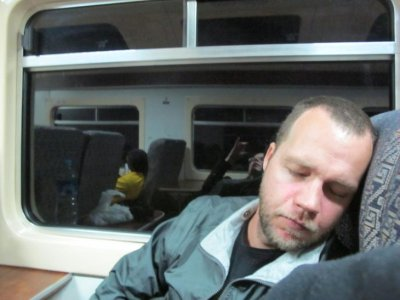 Ben alseep on the homeward bound train, at the end of a long, amazing day exploring Machu Picchu
