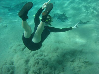Chelle trying to swim against the powerful underwater spring
