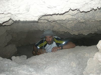 Climbing through caves in the canyon- Valle de Luna