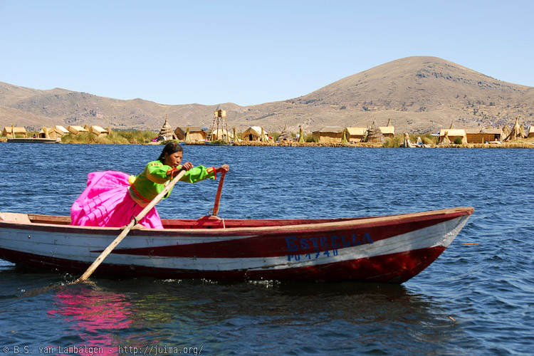 An Uros girl rowing between floating islands