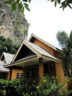 Bungalow under the rock in the mountains