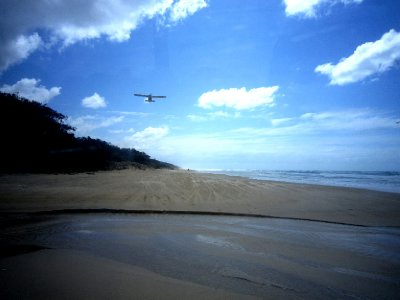 Watch out the plane is coming in to land on the beach highway!