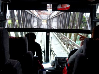 Sharing the single track road across the bridge with a train track YIKES!