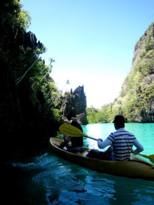 James and Tracy kayaking to the limestone tunnel