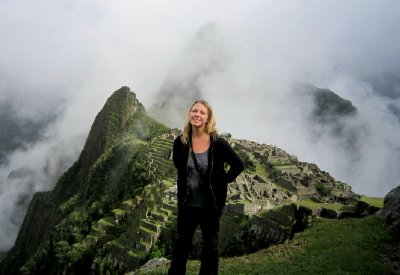 Machu Pichu finally revealing itself through the clouds