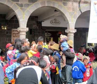another volunteer getting mobbed on Christmas Eve by villagers!