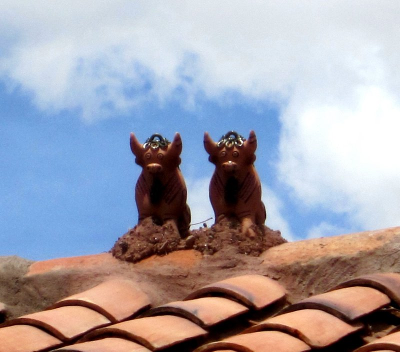 Raqchi village, good luck charms on the roof of every building