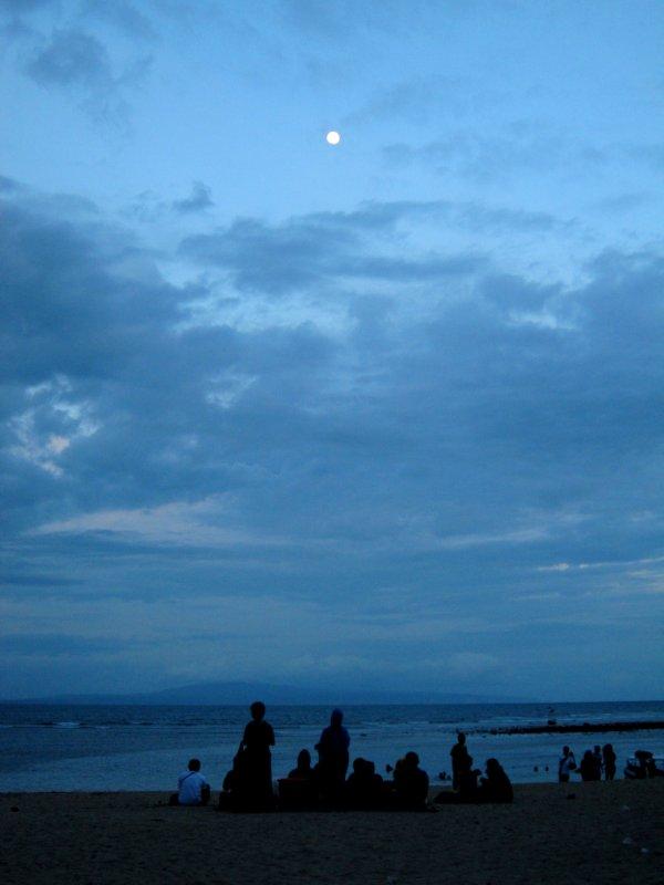 locals appreciating the full moon