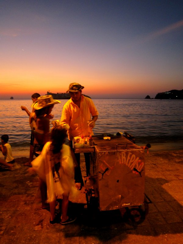 Street vendor during Santa Marta sunset