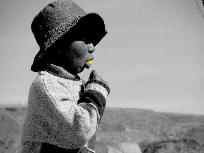 Peruvian Boy Enjoys Lollypop