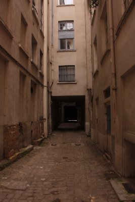 alley to apartment and toilette for others