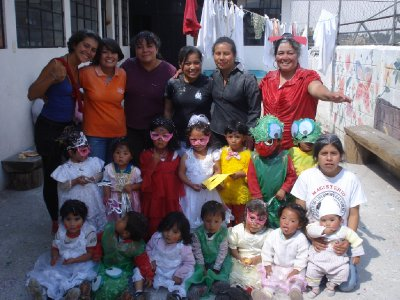Laura with some of the teachers and children on Carnival day in Caras Alegres