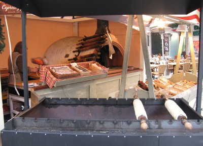 Trdelnik - traditional pastries baked on a rolling spit