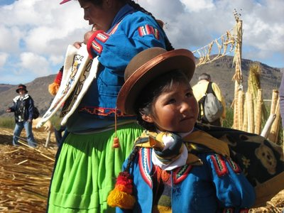 TIT - Uros girl passing by