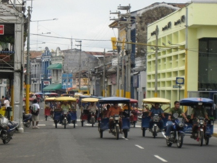 AMZN - 3-wheeled taxis in streets of Iquitos