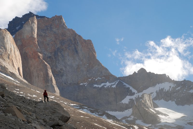 A lone figure dwarfed by the mountains