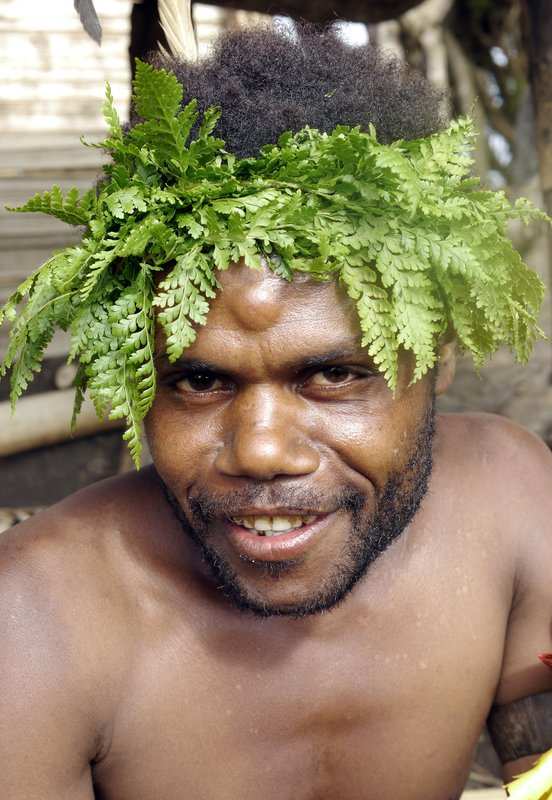 Village man with leaves