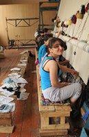 Quba carpet factory women working on big carpet 3