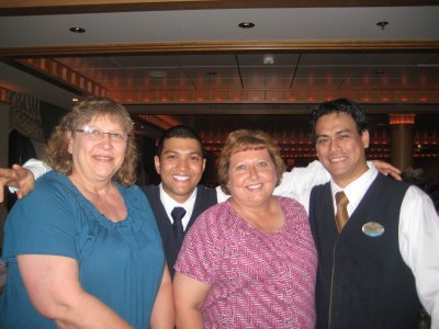Mom and I with our waiter Leonardo and Frederick.  They were the best!!
