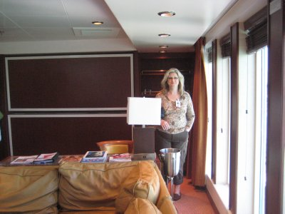 Cindy checking out the Captain's Suite on the Liberty.