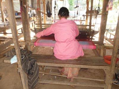 Silk weavers at work