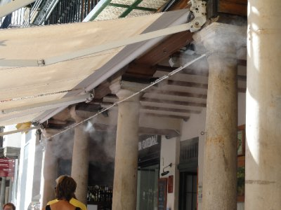 Mists of water sprayed over cafe patrons to provide cool relief