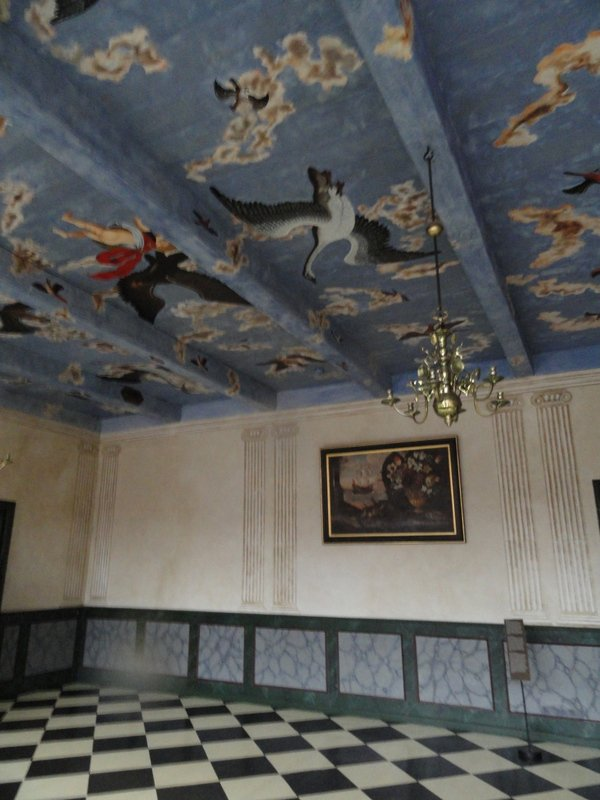 The ceiling decorated as a sky, completed with birds and clouds