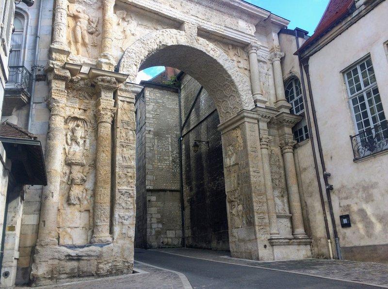 The Porte Noire, a Roman triumphal arch of the 2nd century with extensive sculptural decoration.